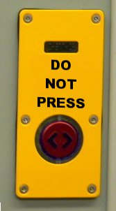 Text reading Do Not Press Button above a red button